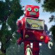 Stock Photo: Giant tin toy robot and garden girl