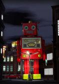Robot zabawka gigantycznych cyny i ulica w nocy — Zdjęcie stockowe