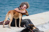 A Beggar with he's two dogs — Stock Photo