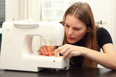 Young woman sewing — Stock Photo