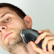 Man shaving face with electric razor — Stock Photo #7465224