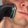 Man shaving face with electric razor — Stock Photo #7465266