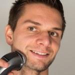 Man shaving face with electric razor — Stock Photo #7605704