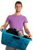 Young man doing the laundry — Stock Photo