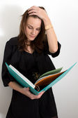 Woman Reading From A Blue Binder — Stock Photo