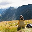 Young woman in mountains - relax scene — Stock Photo