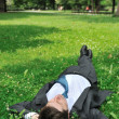 Senior business man relaxing in grass — Stok fotoğraf