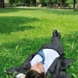 Senior business man relaxing in grass — ストック写真