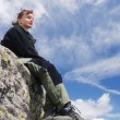 Woman hiker relaxes in mountains — Stock Photo