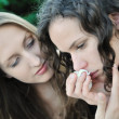 Friends - one teenage girl comforts another — Stock Photo