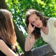Stock Photo: Friends - one teenage girl comforts another