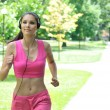 Young woman with headphones running in park — Stock Photo #7171540