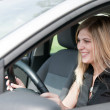 Portrait of young smiling woman driving car — Stock Photo #7171834