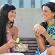 Friends having great time when eating outdoors — Stock Photo