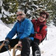 Senior couple on sledge enjoying life — Stock Photo #7172573