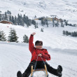Senior woman on sledge having fun — Stock Photo #7172638