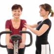Senior woman with trainer — Stock Photo #7173141