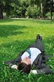 Senior business man relaxing in grass — Stock Photo