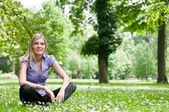 Nature relax - woman in grass — Stock Photo