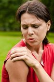 Shoulder injury - sportswoman in pain — Stock Photo