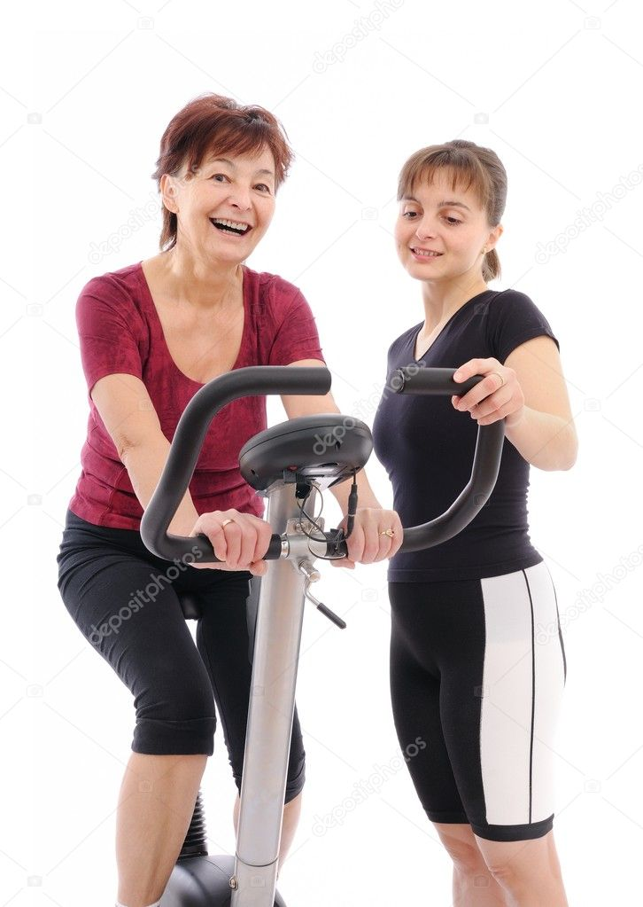 Spinning senior woman with coach — Stock Photo #7172827