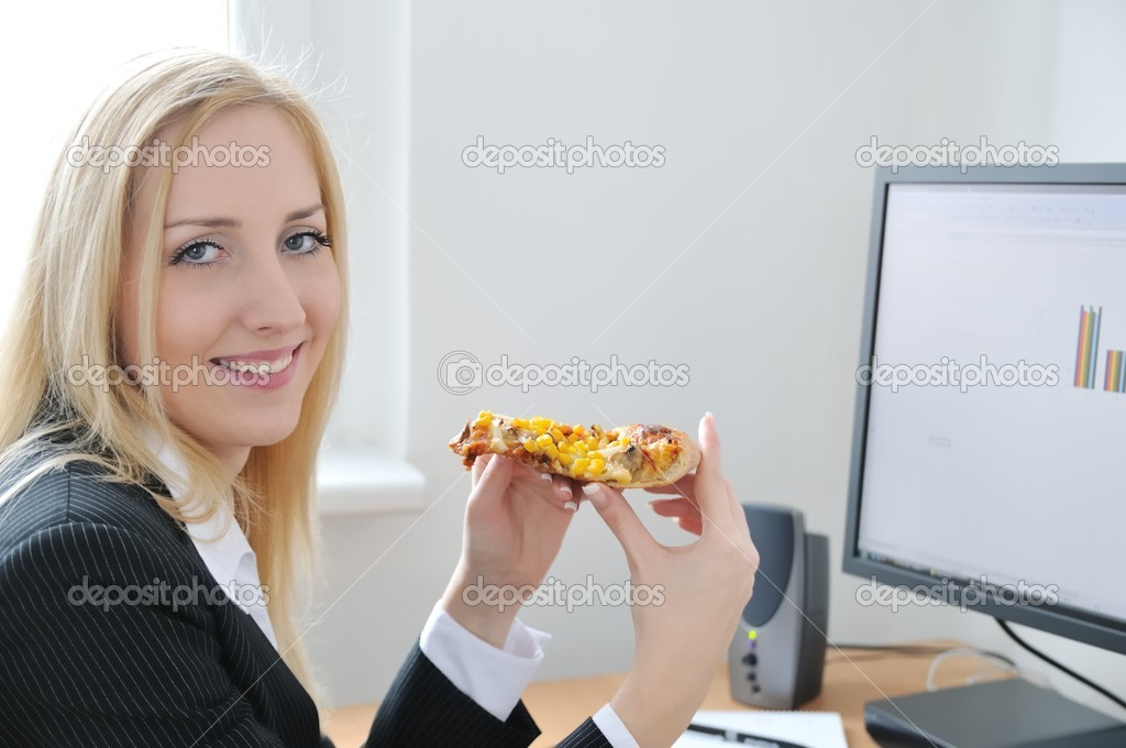 Young smiling business person on work place eating pizza — Stock Photo #7172880