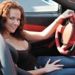 Young beautiful woman in sport car — Stock Photo