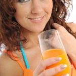 Beautiful young woman with orange juice — Stock Photo