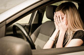 In troubles - unhappy woman in car — Photo