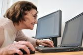 Never old enough - senior woman with computer — Stock Photo