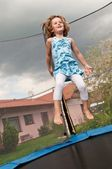 Big fun - child jumping trampoline — Stock Photo
