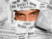 Tired look through the newspapers collage — Stock Photo