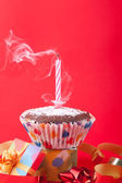 Blowing out birthday candle — Stock Photo