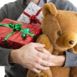 Man holding Christmas presents — Stock Photo #7556853
