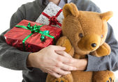 Man holding Christmas presents — Stock Photo