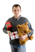 Happy man with Christmas presents — Stock Photo