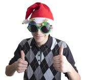 Happy man in Christmas party glasses and hat shows thumbs up — Stock Photo