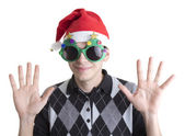 Happy man in Christmas party glasses and hat with hands up — Stock Photo