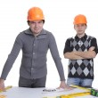 Architects standing over blueprints — Stock Photo
