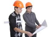 Achitects looking on blueprints — Stock Photo