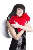 Beautiful angel woman embracing red heart — Stock Photo