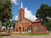 Red bricks church — Stock Photo