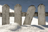 Wooden fence in snow — Stock Photo