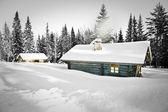 Log cabin in snow — Stock Photo