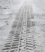 Tire track in snow — Stock Photo