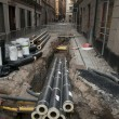Pipes in dug up street — Stock Photo #7187050