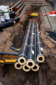 Pipes in dug up street — Stock Photo