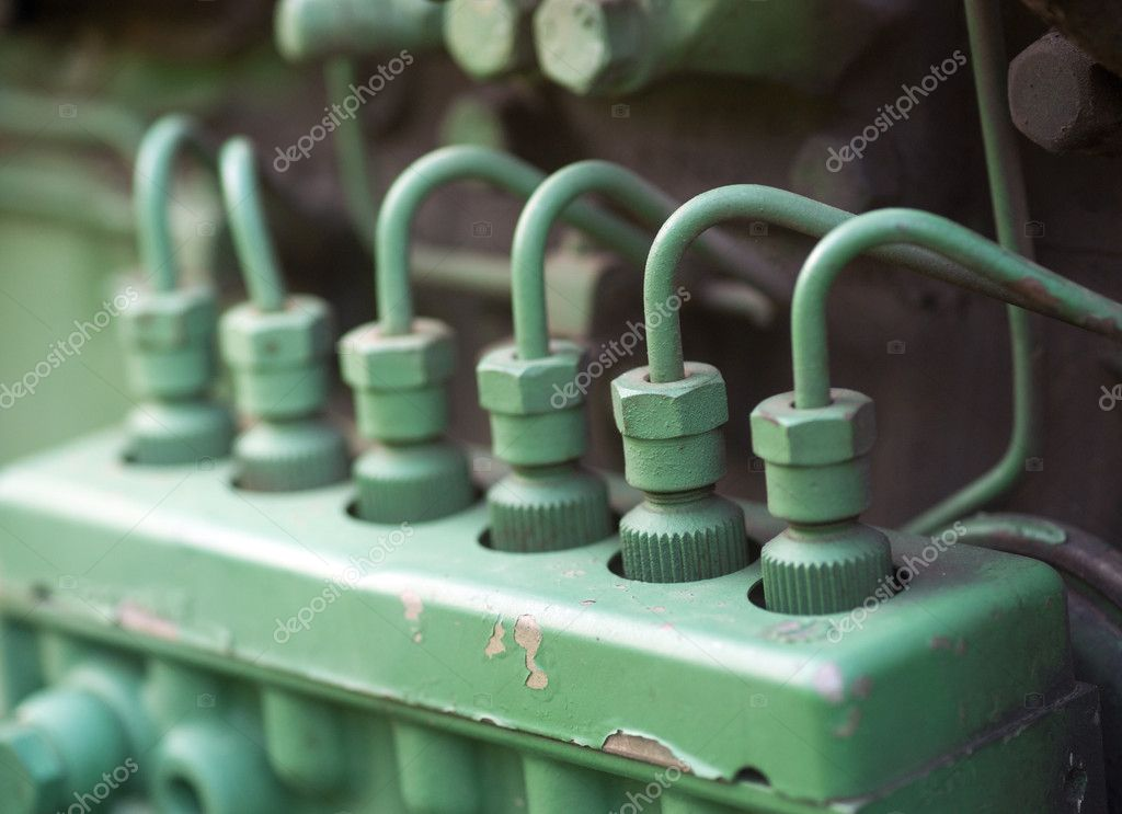 Fuel injectors with spark plugs on vintage machine — Stock Photo #7186249