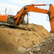 Orange earth mover — Stock Photo