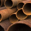 Stack of rusty steel pipes — Stock Photo